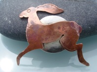 Silver Sea: copper hare brooch